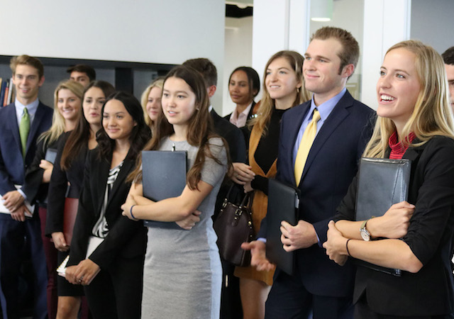 USD students dressed professionally visiting a company