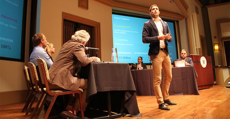 Spain's David Jimenez Burgos, a USD MBA student, gives his pitch during the 2017 V2 Competition.  The 2018 V2 event takes place on April 26 in the KIPJ Theatre.