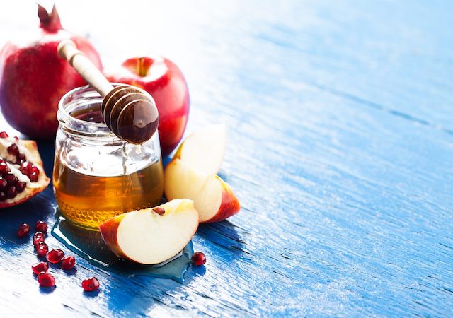 Apples on a table dipped in honey