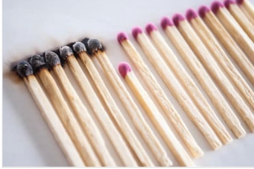 matches in a row with several burned and others not.