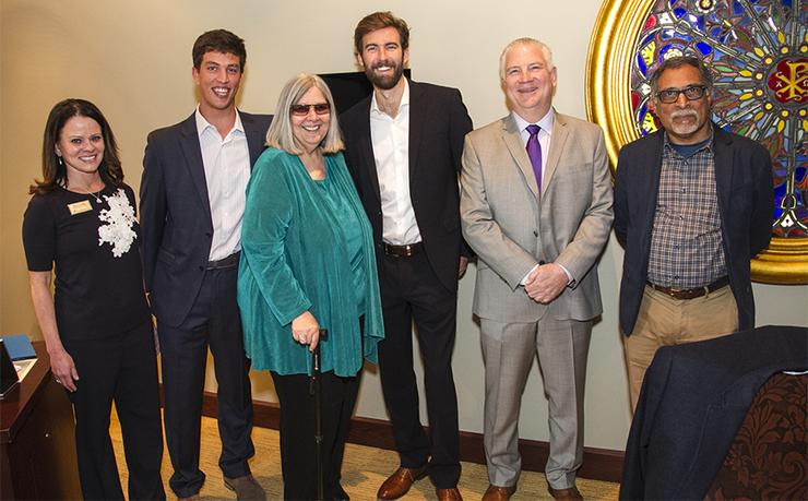 Engineering alumni Chris Szczur (second, left) and Scott Matthews (fourth, left) gifted USD Trustee Darlene Marcos Shiley (middle) with their project, Trek. At right, Tom Lupfer and Venkat Shastri.