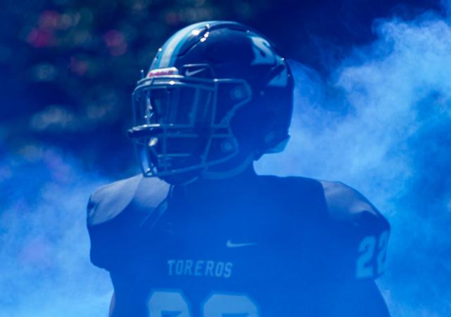 Daniel Tolbert runs through blue smoke