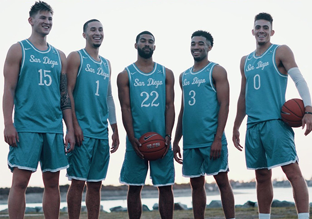 Men's basketball team poses as group