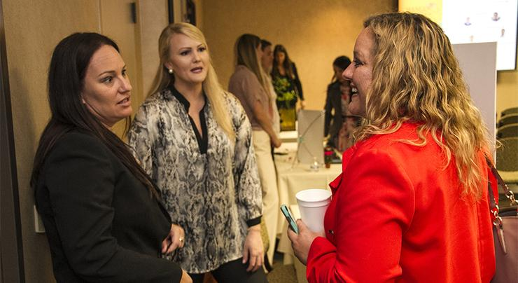 Student entrepreneurs Janaira Quigley, far left, and Anna Kenneally, center, engage with Silvia Mah to discuss their venture, Generations, which was part of the Torero Ventures Catalyzer event.