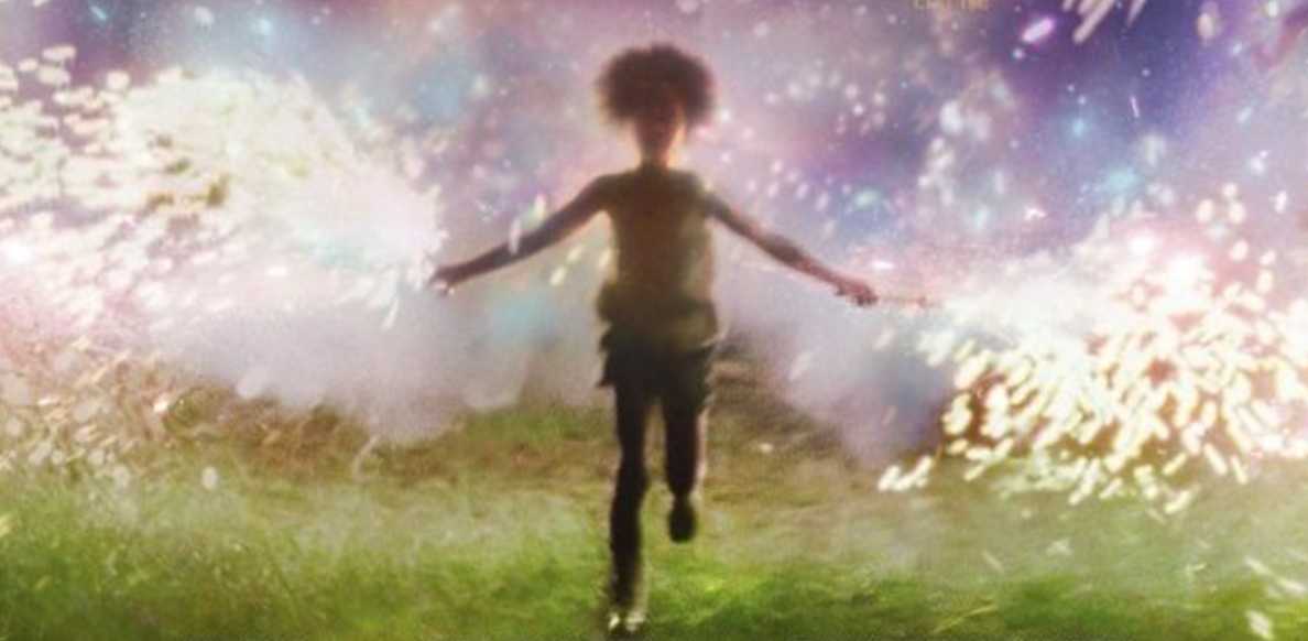 young child silhouette running with sparklers