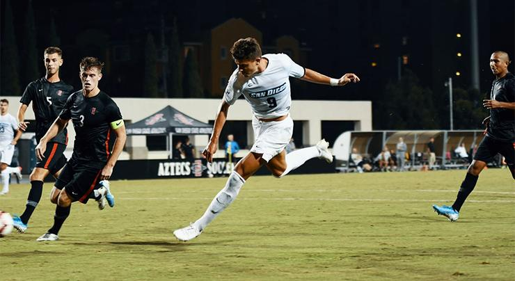 Senior forward Miguel Berry, who scored two goals to lift USD over San Diego State on Aug. 30, advances the ball against the Aztecs.