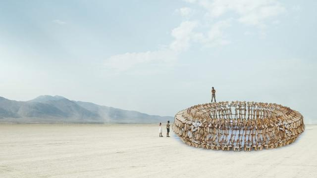 Image of a steel art piece with people near it