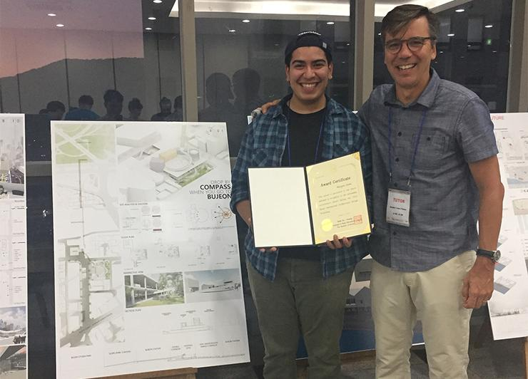 Daniel Rodriguez, left, and USD Professor Daniel Lopez-Perez stand with the project poster that earned Rodriguez's group a Busan International Architectural Design Workshop award in South Korea.