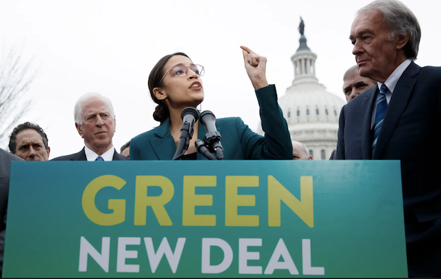 Democratic representative from New York Alexandria Ocasio-Cortez and Democratic Senator from Massachusetts Ed Markey speaking with Green New Deal sign in front of them