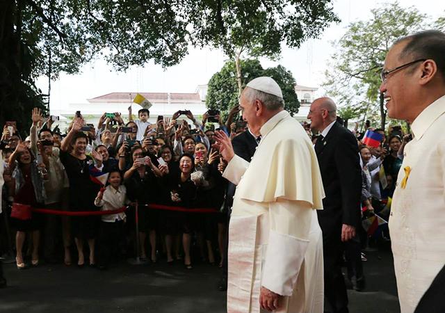 Pope Francis walking through crowd
