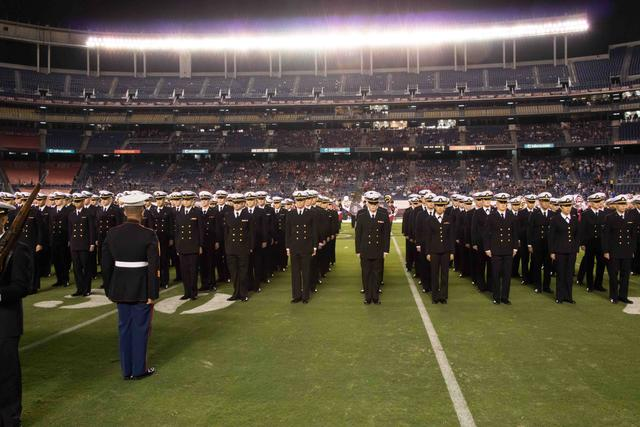 Standing at attention for the National Anthem.
