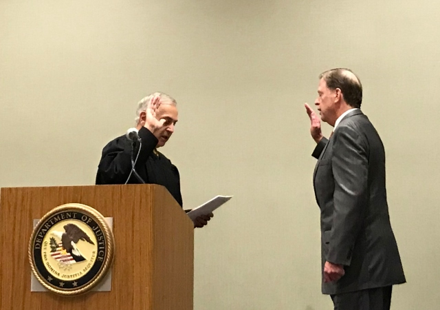Chief Judge Larry Burns swears in United States Attorney Robert Brewer