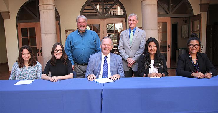 USD President James T. Harris signed a Presidents' Climate Leadership Commitment and USD student leaders joined him to commit their support.