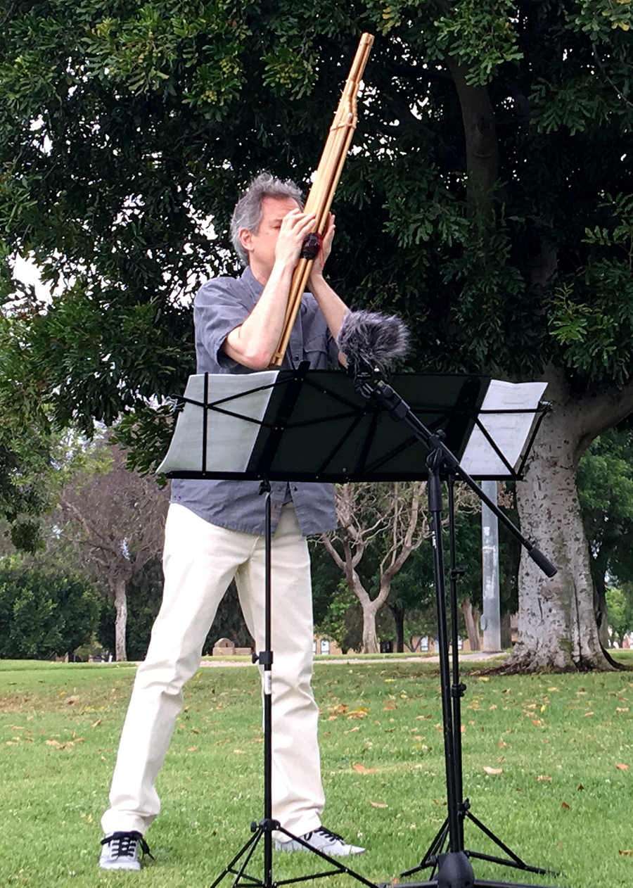 Christopher Adler playing khaen outdoor during a recording session