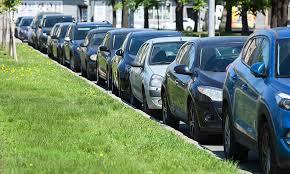 cars parked near grass