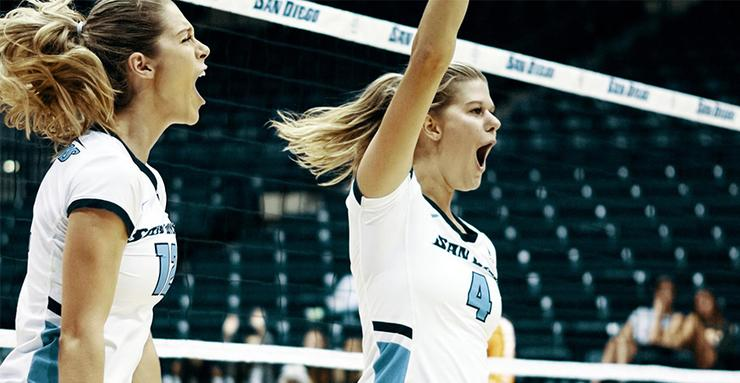 USD volleyball players Lauren Fuller, left, and Addie Picha, celebrate a point during a recent match. Both players contributed to a successful 3-0 week against WCC competition.