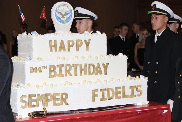 Color guard parades in the cake.
