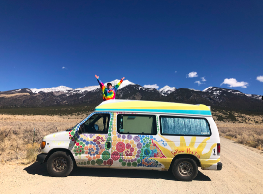 Van in front of a mountain