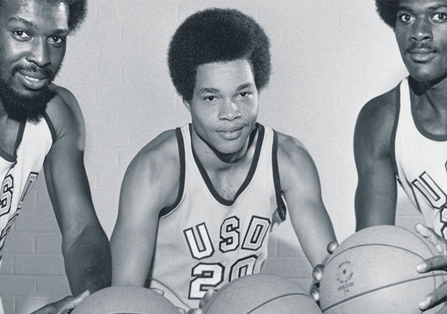 Stan Washington with USD Men's Basketball teammates