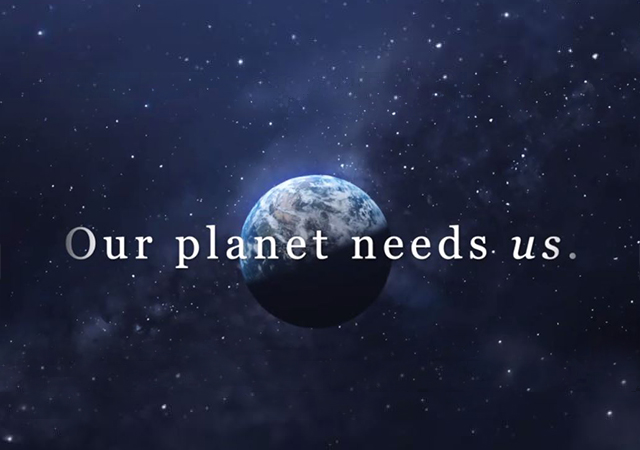 """A picture of the earth with the words """"Our Planet Needs Us"""" across the screen."""