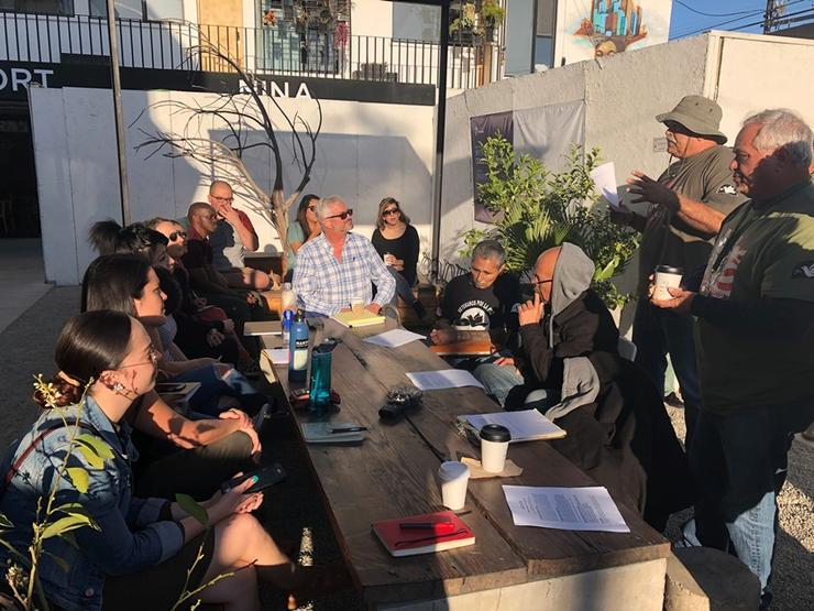 Kroc students talking with deported U.S. veterans in Tijuana