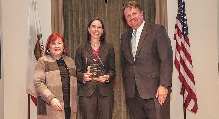 Kroc School of Peace Studies Dean, Patricia Marquez, center, accepts the Rotary District 5340 Pathways to Peace Award at the Seventh Annual Peace Forum.