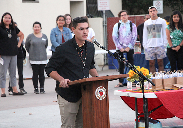 Gabriel Fallis, USD students and AISO Chairman, speaks to the audience during Monday's Mata'yuum Crossroads renaming celebration.