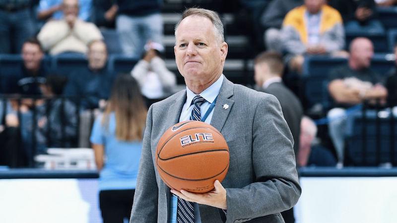 Bill McGillis holding a basketball