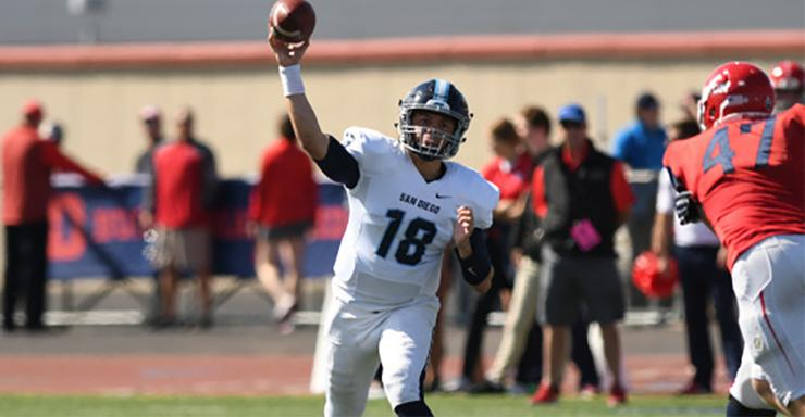 San Diego quarterback Anthony Lawrence throws a pass during Saturday's 63-7 victory over Davidson. The Toreros' win clinched the PFL championship.
