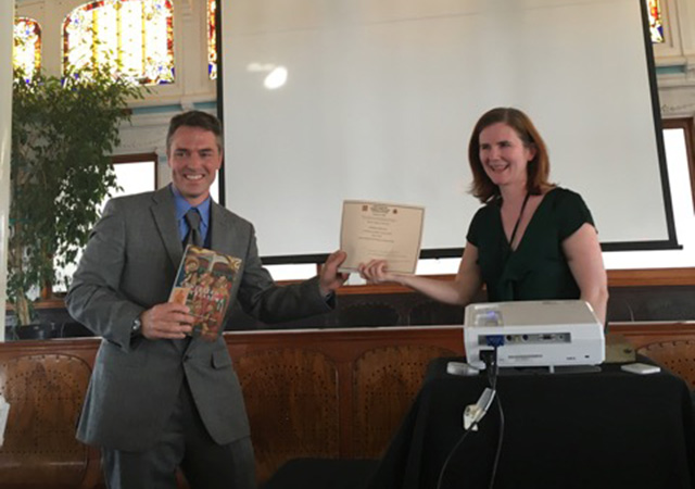 Professor Barton receiving the 2013-2015 Best First Book Prize at the Association's annual meeting from the prize committee chairperson, Dr. Erin Rowe of The Johns Hopkins University.