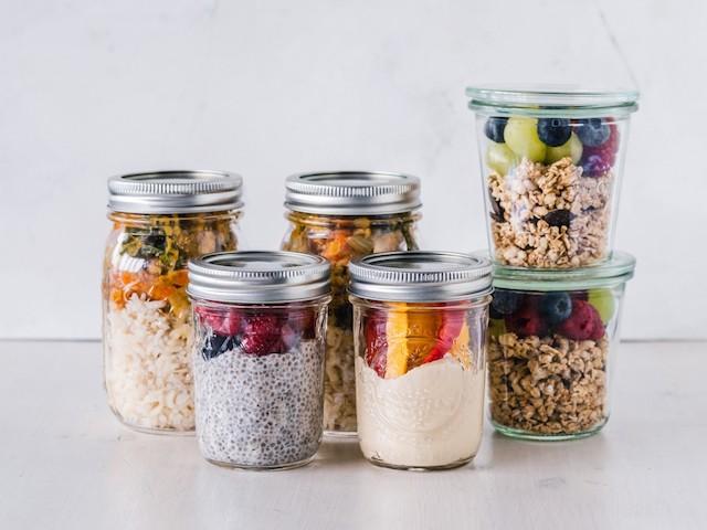 Mason jars storing various food items